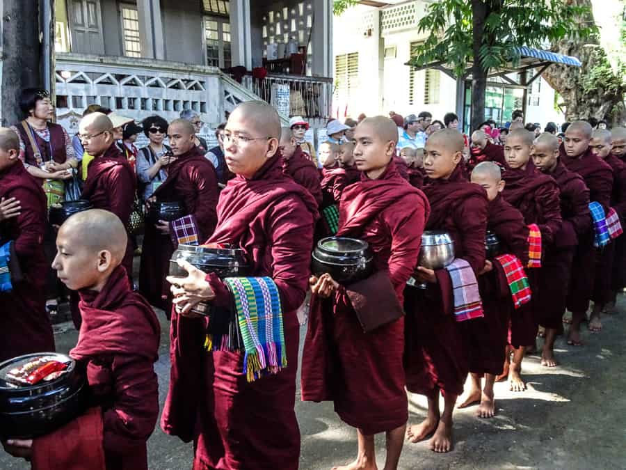 Monks looking everywhere but the cameras flashing in their faces