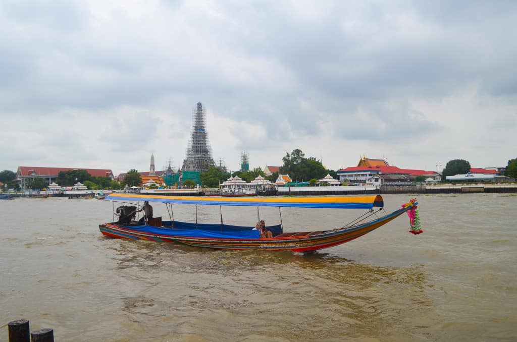 Wat Arun, under construction, on the banks of the Chao Phraya River