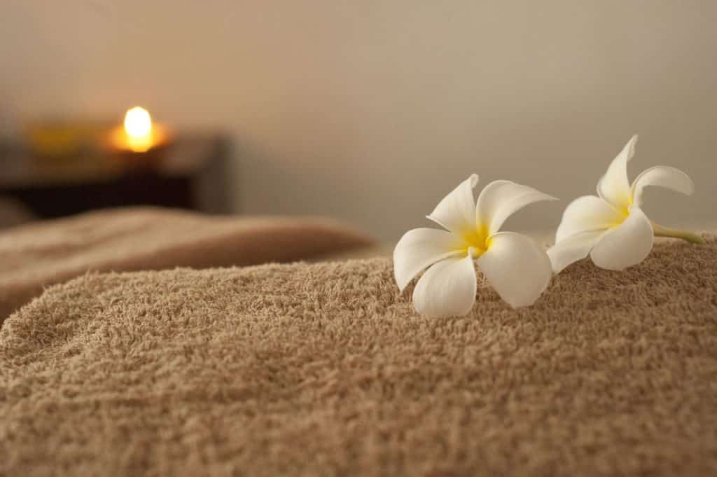 spa setting with candle and flowers