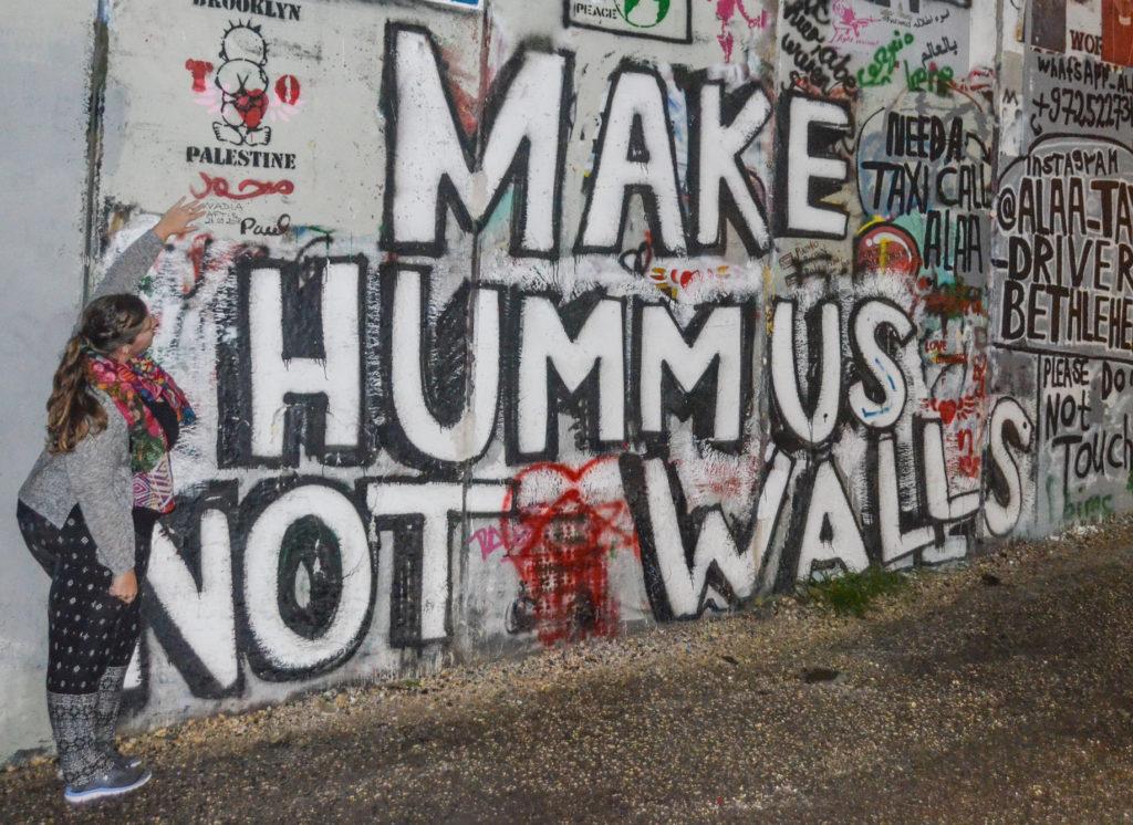 Make Hummus Not Walls street art in Bethlehem
