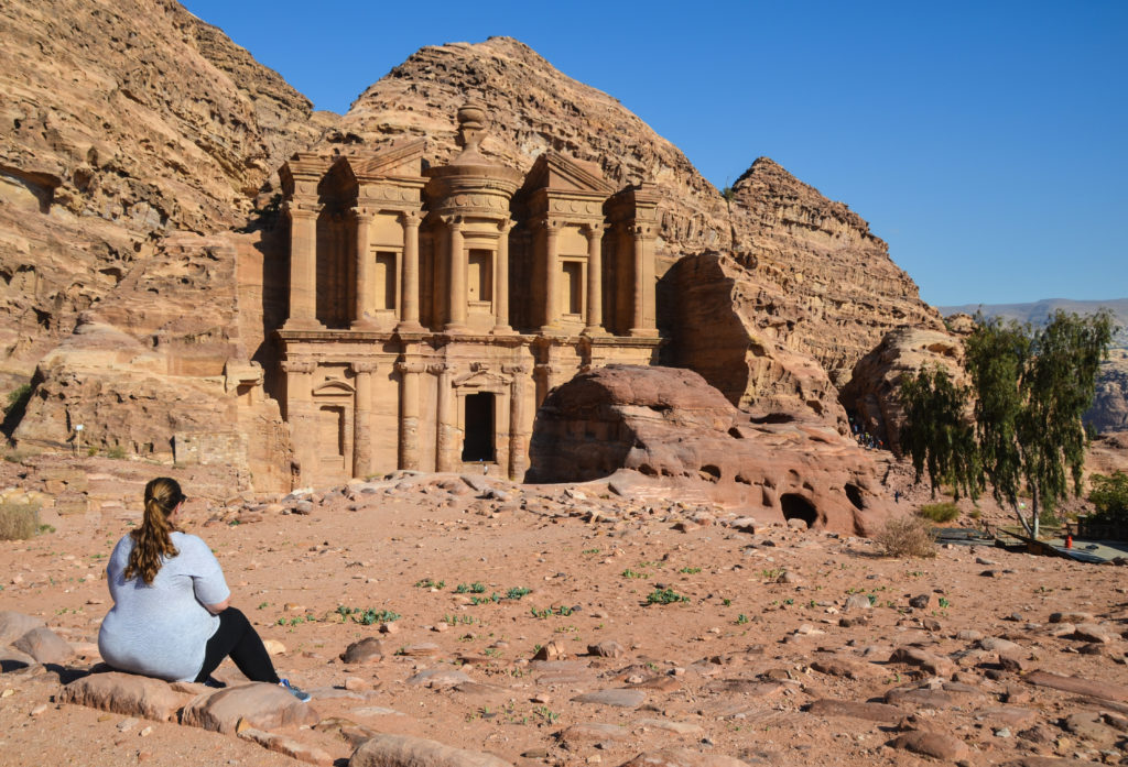 Sitting on the ground looking at the Petra Monastery in Jordan