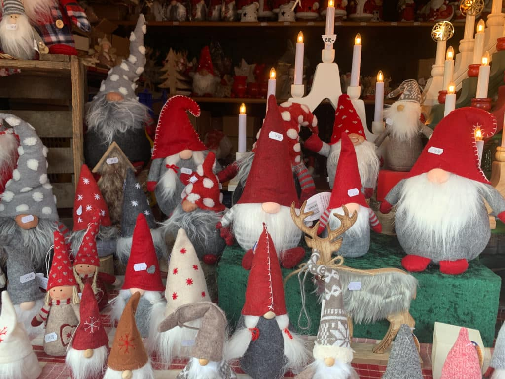Santas at a Christmas market stall in Colmar, France