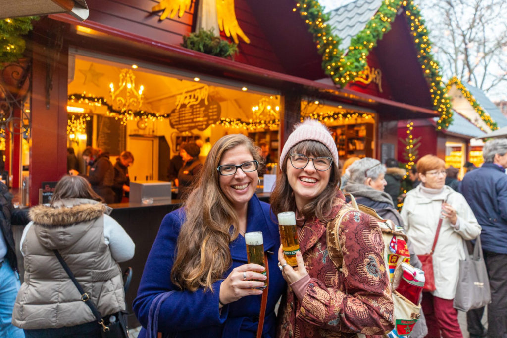 Hannah and Megan drinking Kolsch at the Christmas market