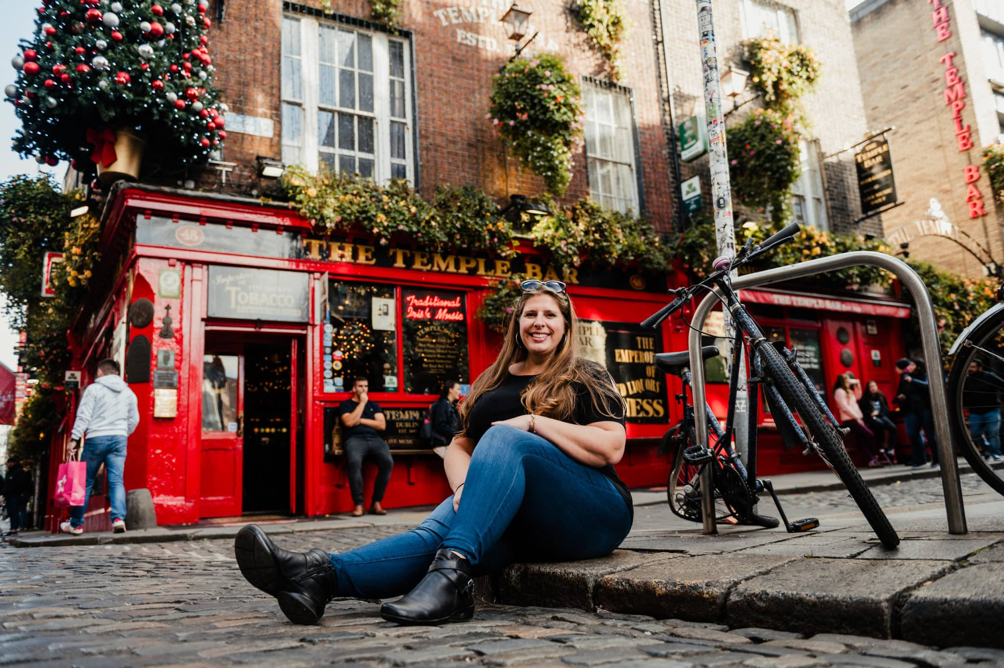 Hannah Logan sitting in Temple Bar, Dublin
