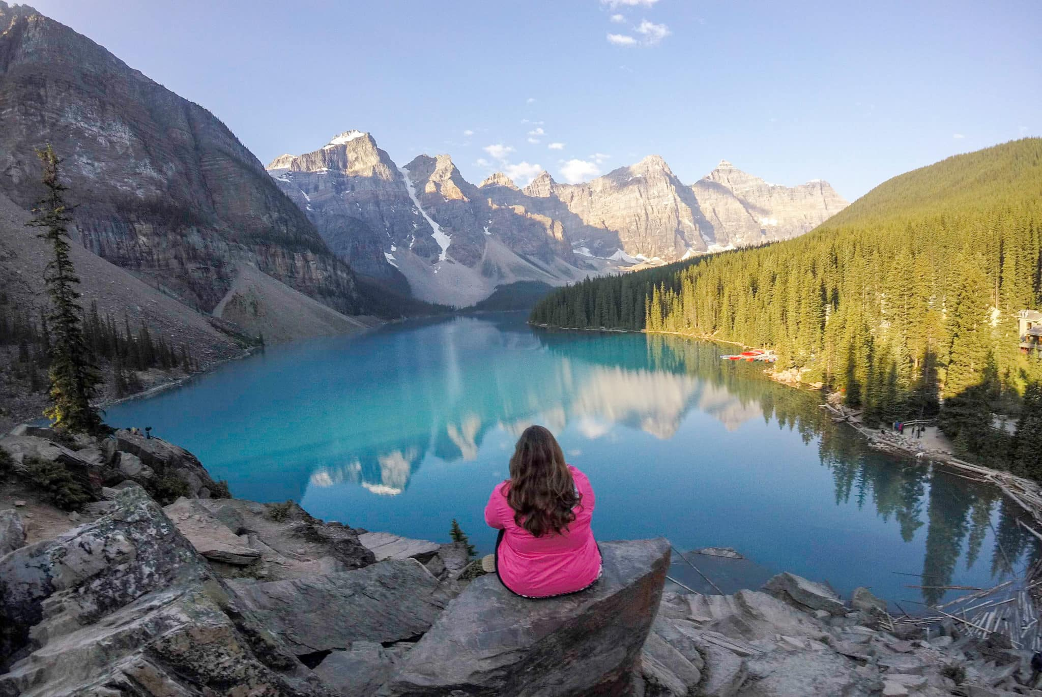Hannah Logan sitting at Lake Morraine, Alberta