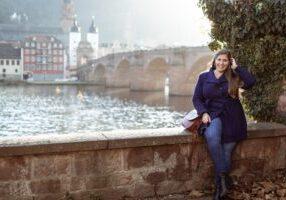 Hannah sitting in font of the Old Bridge in Heidelberg